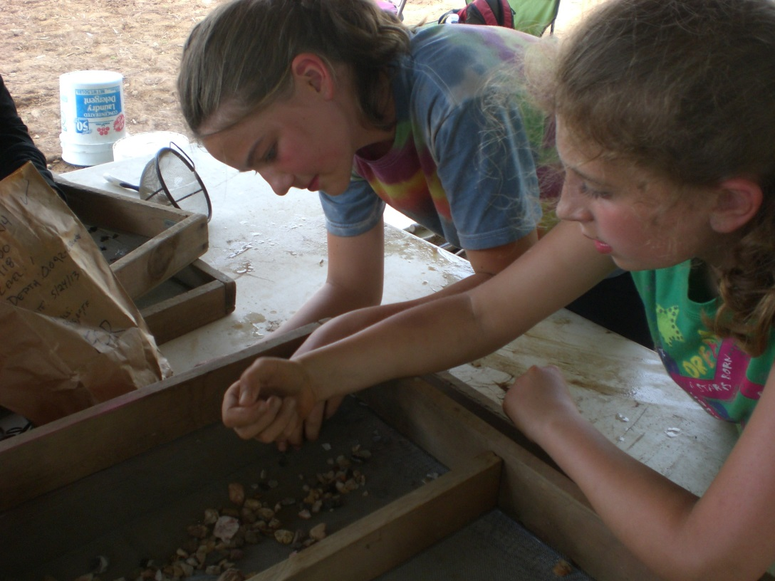 Young volunteers sort and clean 